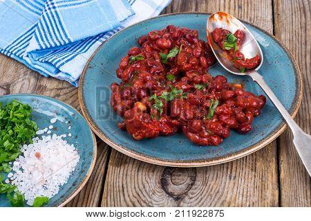 Baked hot beans in tomato sauce. Studio Photo