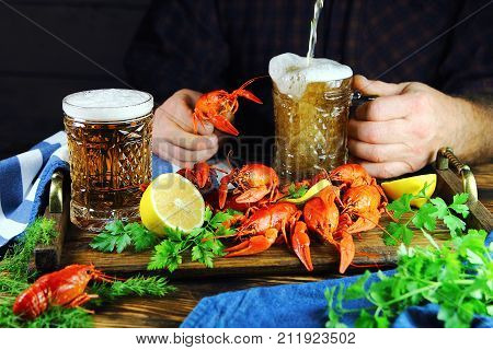 a man drinking beer with boiled crawfish