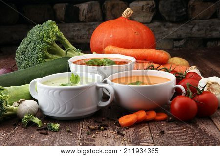 Variety of colorful vegetables cream soups and ingredients for soup. Concept of healthy eating or vegetarian food