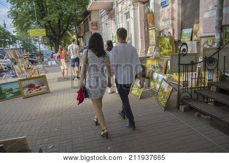 Kiev Ukraine - July 09 2017: Citizens pass by street gallery on Vladimirskaya Street