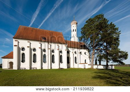 Beautiful St. Coloman church near Fussen on a beautiful autumn day in Bavaria, Germany