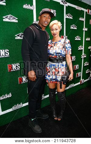 NEW YORK-FEB 1: Football player Brandon Marshall (L) and wife Michi Marshall attend the Roc Nation Sports Celebration at the 40/40 Club on February 1, 2014 in New York City.
