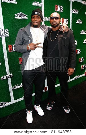 NEW YORK-FEB 1: Football player Dez Bryant (L) and guest attend the Roc Nation Sports Celebration at the 40/40 Club on February 1, 2014 in New York City.