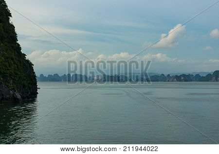 Halong Bay With Mountain Islands In The Distance