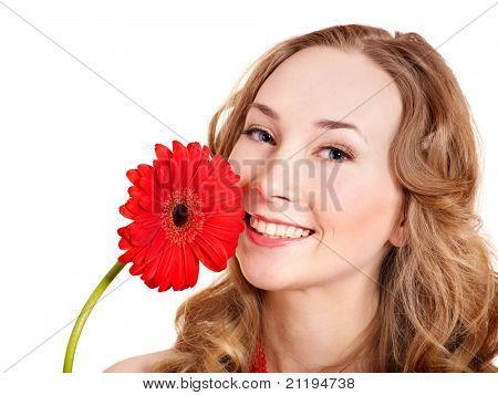 Happy young woman holding red flower.