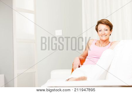 Happy Confident Woman Relaxing On A Couch