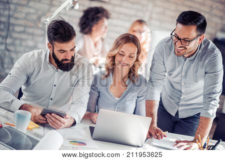 Business people in modern office.Group of young business people in a meeting at office.