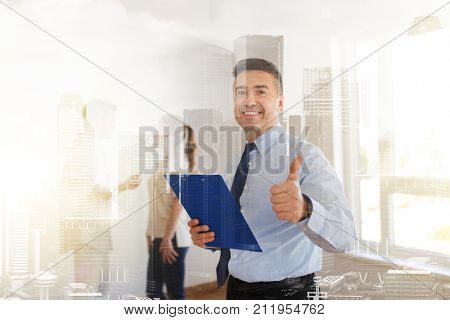 real estate, mortgage and people concept - happy smiling realtor with clipboard showing thumbs up and couple at new home over city buildings background and double exposure effect