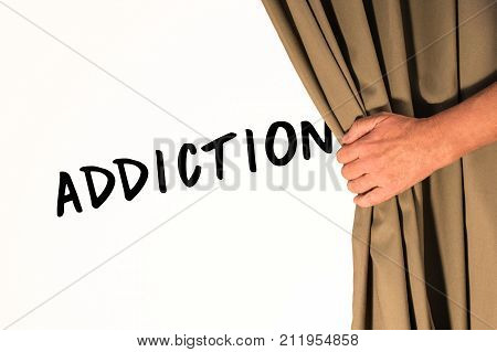 The word Addiction being revealed from behind a curtain