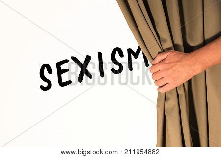 The word Sexism being revealed from behind a curtain