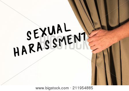 The words Sexual Harassment being revealed from behind a curtain