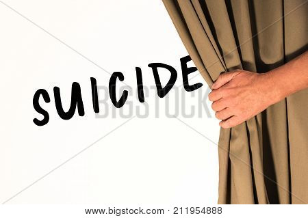 The word Suicide being revealed from behind a curtain