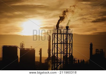 Petrochemical plant in silhouette image on sky sunset