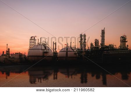 Gas storage spheres tank in oil refinery industrial on sky sunset background Petrochemical plant with sky evening background