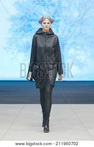 ZAGREB, CROATIA - OCTOBER 28, 2017: Fashion model wearing clothes designed by Marina Design and a bag designed by Marija Ivankovic at the 'Fashion.hr' fashion show