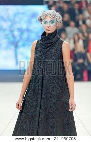 ZAGREB, CROATIA - OCTOBER 28, 2017: Fashion model wearing clothes designed by Marina Design at the 'Fashion.hr' fashion show