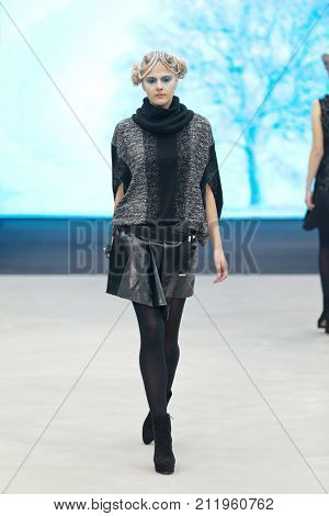 ZAGREB, CROATIA - OCTOBER 28, 2017: Fashion model wearing clothes designed by Marina Design and a bracelet designed by Marija Ivankovic at the 'Fashion.hr' fashion show