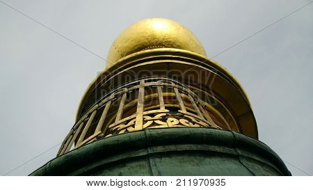 The spire of the tower of the Savior in Copenhagen from close range