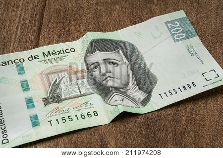 A 200 mexican pesos bill seems to be sad perhaps because of its weakness against the dollar.