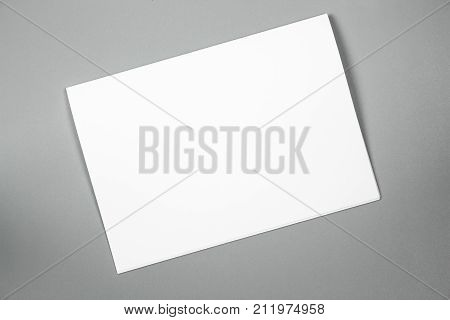Blank portrait A4. brochure magazine isolated on gray, changeable background / white paper isolated on gray. Mock-up of blank white paper for display your product montage or artwork.