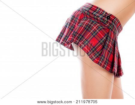 Close-up of beautiful sexy legs in red short skirt. Isolated on a white background