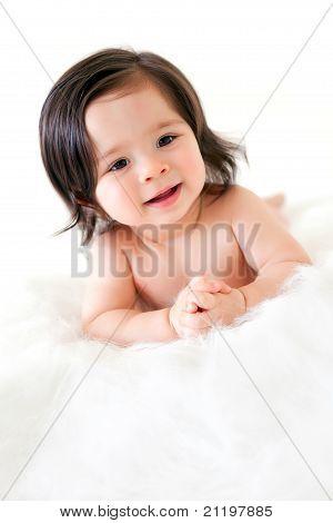A Pretty Baby Girl on a Fur Rug