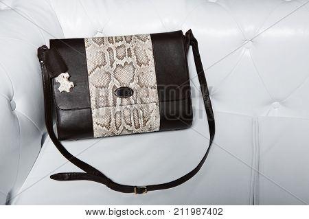 women black purse over shoulder for everyday