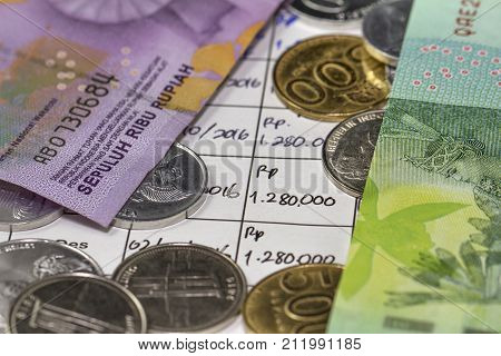 Spending Money and Payment Illustrated with coins and membership monthly payment in handwriting