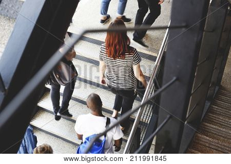 People Walking Up to Office Stairway to Work