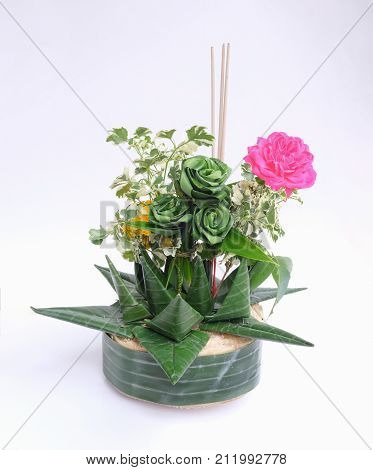 Kratong object made by banana leaf and ornamental plants on Loy Kratong day in Thailand. Isolated on white background