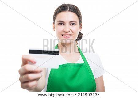 Portrait Of Beautiful Merchandiser Giving Debit Card