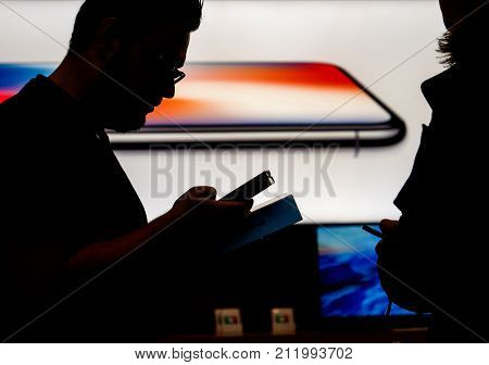 STRASBOURG FRANCE - NOV 3 2017: Apple Genius selling the latest Apple iPhone X to first customers in France at Apple Store