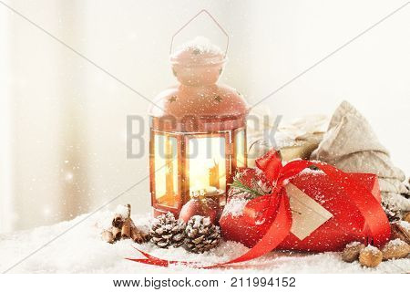 Christmas presents or gifts with elegant bow and christmas decorations on bright snowy background christmas concept