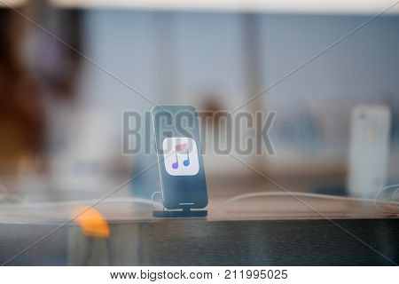 Latest Apple Iphone X In Docking Station Reflection From Street