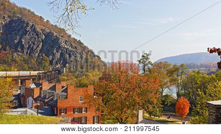 Autumn landscape of Harpers Ferry historic town in West Virginia USA. ¬¬¬A view on Shenandoah River railroad tunnel and mountains ridge.