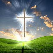 Christian cross against the sky in a blaze of glory. Religious symbol of Christianity poster