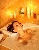Young woman take bubble  bath. poster