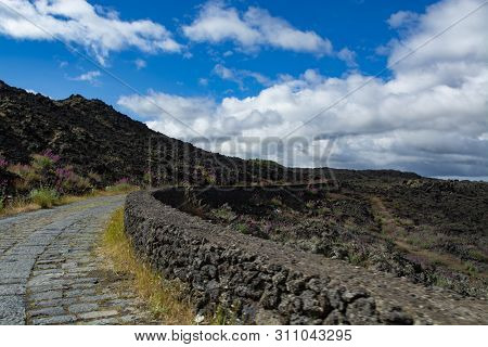 Stone Road Through Black Lava Fields On Slopes Of Mount Etna Volcano, Car Access To National Park Of