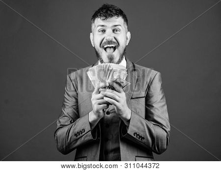Wealthy and successful. Making money with his own business. Business startup loan. Bearded man holding cash money. Rich businessman with us dollars banknotes. Currency broker with bundle of money poster