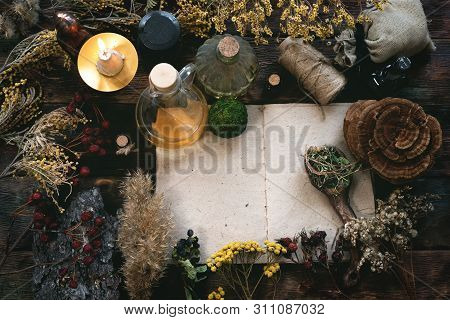 Recipe Magic Book And Various Dry Herbs On A Table Of Witch Doctor Or A Herbal Medicine Essential Oi