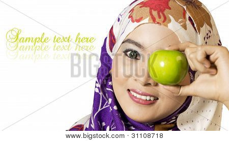 An apple a day keeps the doctor away - Woman with green apple