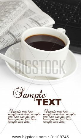 Cup of coffee with newspaper and notebook