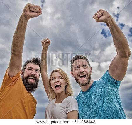 Woman and men look confident successful sky background. Behaviors of cohesive team. Celebrate success. Yes we can. Ways to build ohesive team. Threesome stand happy confidently with raised fists poster