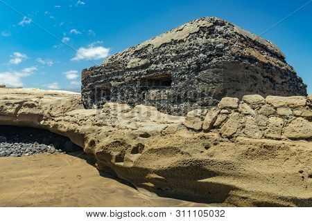 View Of The South Coast Of El Medano. Old Military Bunker With Two Embrasures Towering Right At The
