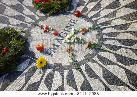 New York, Usa - January 2, 2008: objects deposited in John Lennon Memorial in Central Park.