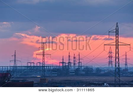 electric powerlines and pylons at dusk