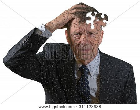Front View And Face Of Senior Caucasian Man Afraid Of Dementia And Alzheimers Disease Using Jigsaw C
