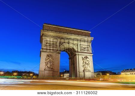 Paris France City Skyline Night At Arc De Triomphe And Champs Elysees