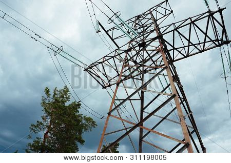 High Voltage Pylons And Cables In An Dutch Agricultural Landscape With Silage Maize Cultivation