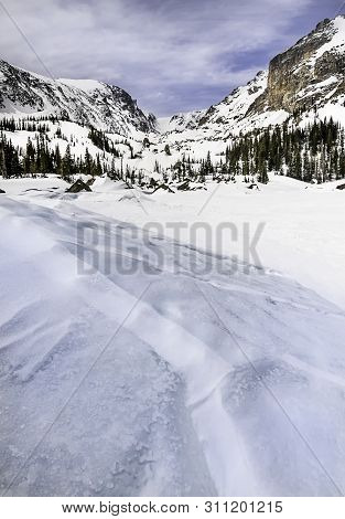 Lake Haiyaha In The Winter Located In Rocky Mountain National Park
